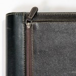 Exterior stitching and zippered pouch